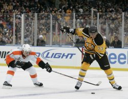 Bruins Ryder and Flyers Briere in NHL Winter Classic at Fenway Park in Boston, MA.