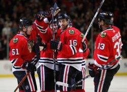 Blackhawks celebrate Ladd's goal against Bruins in Chicago