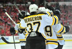 Members of the Boston Bruins celebrate in Washington