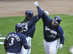 Brewers Betancourt, Weeks and Fielder celebrate home run against Cardinals during NLCS in Milwaukee, Wisconsin