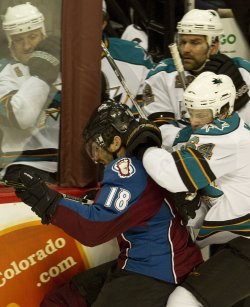 Sharks McGinn Checks Avalanche Yelle in Game Six in Denver