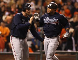 Atlanta Braves Brian McCann congratulates Melky Cabrera as they tie the game against the Giants at AT&T Park in San Francisco