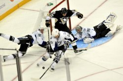 Tampa Bay Surounds Penguins Talbot in Pittsburgh