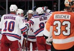 New York Rangers Marian Gaborik and Matt Gilroy suround Ryan Callahan at Madison Square Garden in New York