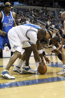 Antawn Jamison Scrambles for Loose Ball in Washington