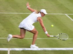 Vera Dushevina volleys the ball on the first day of Wimbledon.