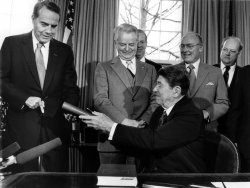 PRESIDENT REAGAN HANDS OVER COPIES OF THE BUDGET