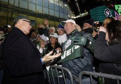 New York Jets owner Woody Johnson talks to Jets fans during a Jets playoff rally at Times Square in New York