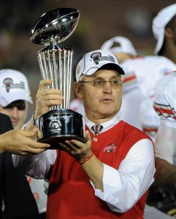 Ohio State head coach Jim Tressel holds up the Leishman Trophy after the Rose Bowl in Pasadena, California