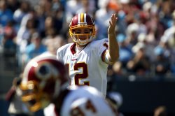 Washington Redskins quarterback John Beck (12) calls a play against the Carolina Panthers