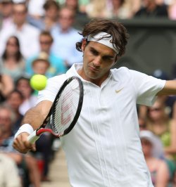 Roger Federer celebrates winning a point on the first day of Wimbledon