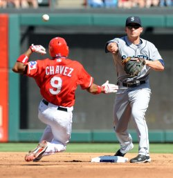 Mariners Ackley turns a double play against the Rangers in Arlington
