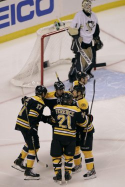 Bruins celebrate goal against Penguins at TD Garden in Boston, MA.