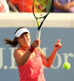 Martina Hingis plays in the women's doubles match at the U.S. Open in New York