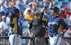 Braun is high fived by weeks during spring training in Arizona