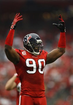 Houston Texans Defensive End Mario Williams pumps up the crowd at Reliant Stadium in Houston