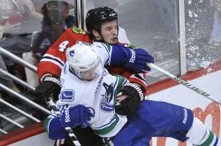 Canucks Hansen and Blackhawks Hjalmarsson collide in Chicago
