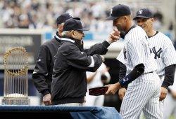 Joe Girardi, Yogi Berra and Whitey Ford watch New York Yankees Derek Jeter receive his World Series championship ring at Yankee Stadium in New York