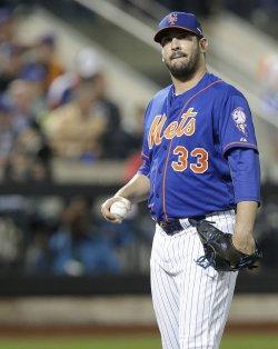Mets starting pitcher Matt Harvey reacts after 3 runs score