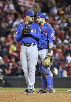 Rangers Gonzalez and Napoli talk during game 1 of the World Series against the Cardinals in St. Louis