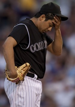 Rockies De La Rosa Reacts During Shaky Start Against the Padres in Denver
