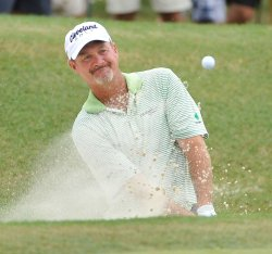 Kelly chips out of bunker on the 1st hole at 93rd PGA Championship
