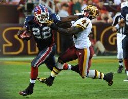 Buffalo Bills' running back Fred Jackson runs against Redskins' Kareem Moore in Washington