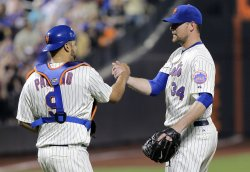 New York Mets starting pitcher Mike Pelfrey and Ronny Paulino at Citi Field in New York