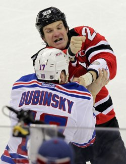 New Jersey Devils David Clarkson and New York Rangers Brandon Dubinsky fight at the Prudential Center in New Jersey