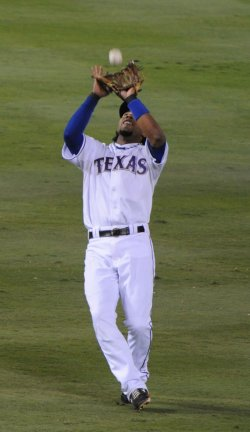 Rangers Alvis Andrus catches a pop fly to end the first inning of game 5 of the World Series