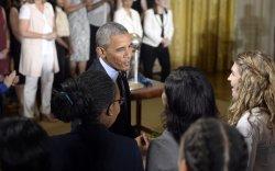 President Barack Obama greets some guests