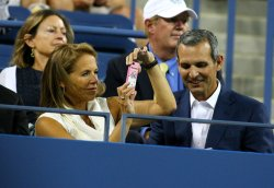 Katie Couric and her fiance John Molner watch the at the U.S. Open in New York