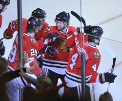 Blackhawks Bickell, Frolik, Campbell and Hjalmarsson celebrate goal against Canucks in Chicago