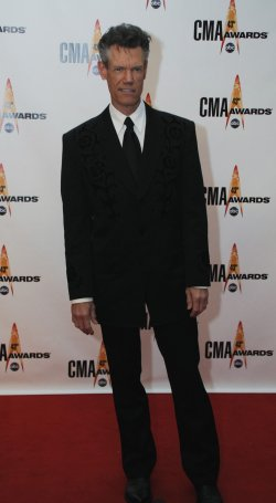 Randy Travis arrives at the 43rd Annual CMA Awards in Nashville
