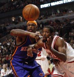 Knicks' Harrington and Bulls' Salmons go for loose ball in Chicago