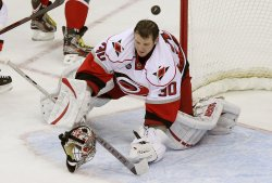 Hurricanes goalie Cam Ward loses his helmet against the Capitals in Washington D.C.
