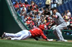 Nationals' Nyjer Morgan slides back into first against the Florida Marlins in Washington