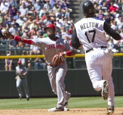 Reds Phillips Completes Double Play Against Rockies Helton in Denver