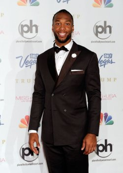 Larry Fitzgerald arrives at the 2013 Miss USA competition in Las Vegas