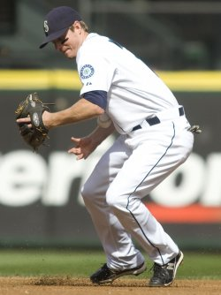 MARINERS SHORTSTOP JOSH WILSON COMMITS AN ERROR IN THE FIRST INNING.