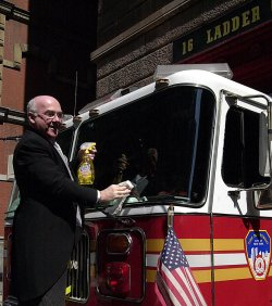 Butler Paul Hogan gives cleaning tips to New York City's Firemen