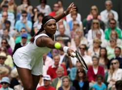 Serena Williams returns at Wimbledon.