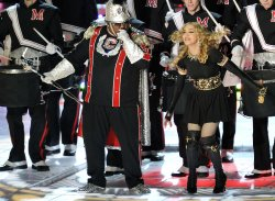 Madonna and Cee Lo Green perform during half time
