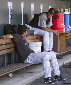 Rockies Pitchers Jimemez and De La Rosa Talk in Denver