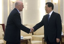 U.S. Treasury Secretary Paulson shakes hands with Chinese President Hu during the 5th U.S.-China Economic Dialogue in Beijing