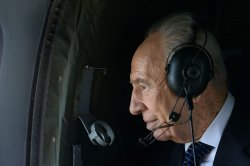 File Photo of Israeli President Shimon Peres In A Helicopter