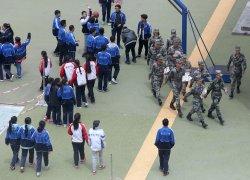 Chinese soldiers walk through a Tibetan middle school in Ganzi Prefecture
