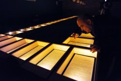 A man looks at the original manuscript of Albert Einstein's General Theory of Relativity in Jerusalem