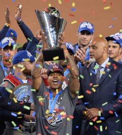 Team USA's Marcus Stroman hoists trophy after 8-0 win over Puerto Rico in Los Angeles