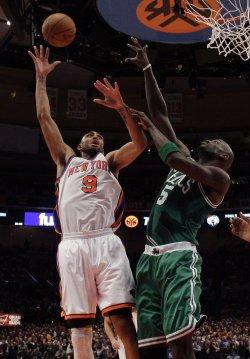 Boston Celtics Kevin Garnett tries to block a shot from New York Knicks Jared Jeffries at Madison Square Garden in New York